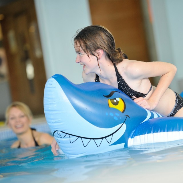Children play in the swimming pool at luxury family hotel in Dorset, Moonfleet Manor