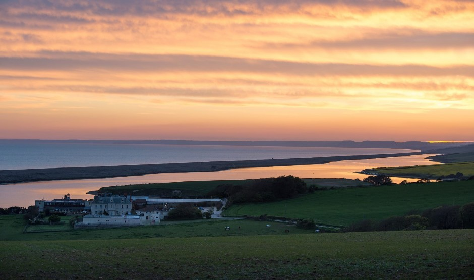 The sunset over Chesil beach and Moonfleet Manor – a luxury family hotel in Dorset