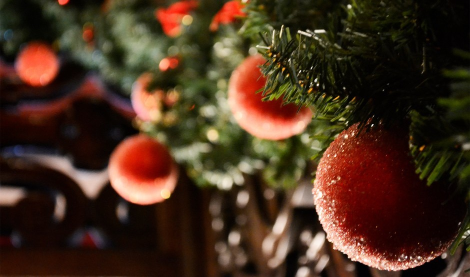 Christmas baubles decorating a tree.