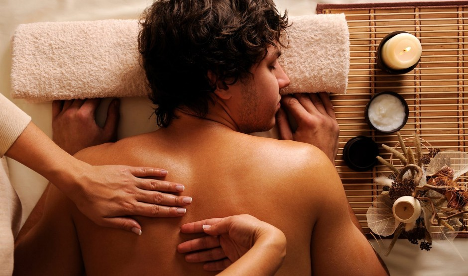 Back massage taking place in our treatment room.