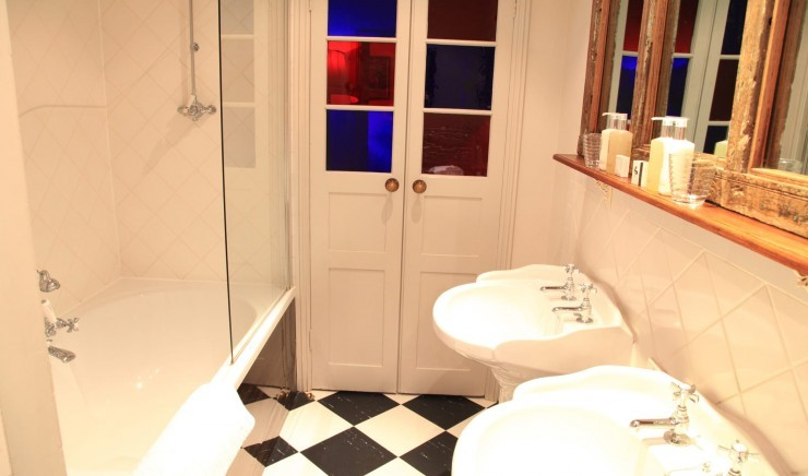 Bathroom in a deluxe two bedroom family room at Moonfleet Manor country hotel.